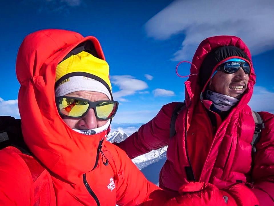 Simone Moro (left) and Pemba Gelje Sherpa facing the wind on Mera Peak summit, before attempting winter Manaslu