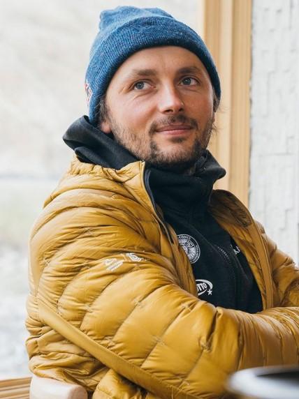 Portrait of Andrzej Bargiel in down jacket