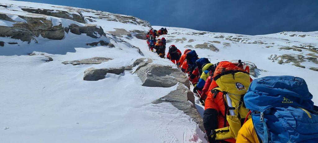 Line of climbers heading up