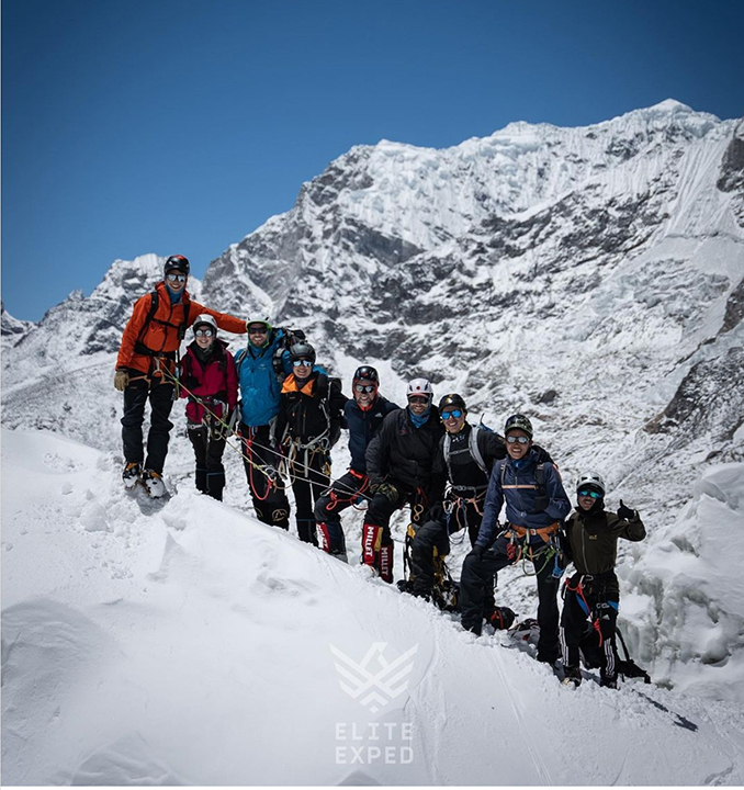 Climbers smiling in the Khumbu Icefall, Mount Everest