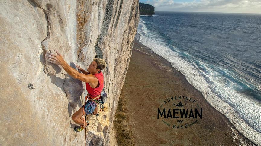 A climber on a limestone cliff in Polynesia