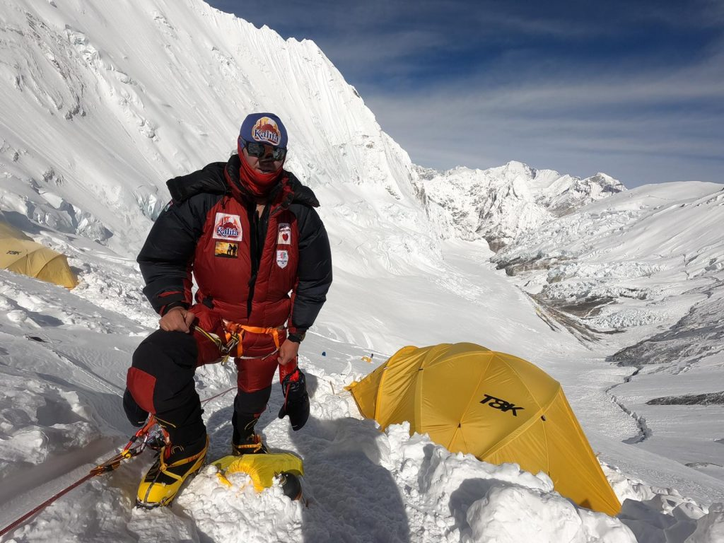 A climber at a snowy camp on Everest
