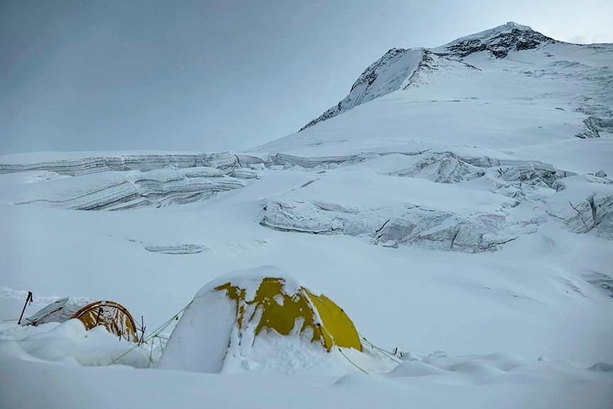 A snowy Camp 1 at a huge flat saddle on Dhaulagiri
