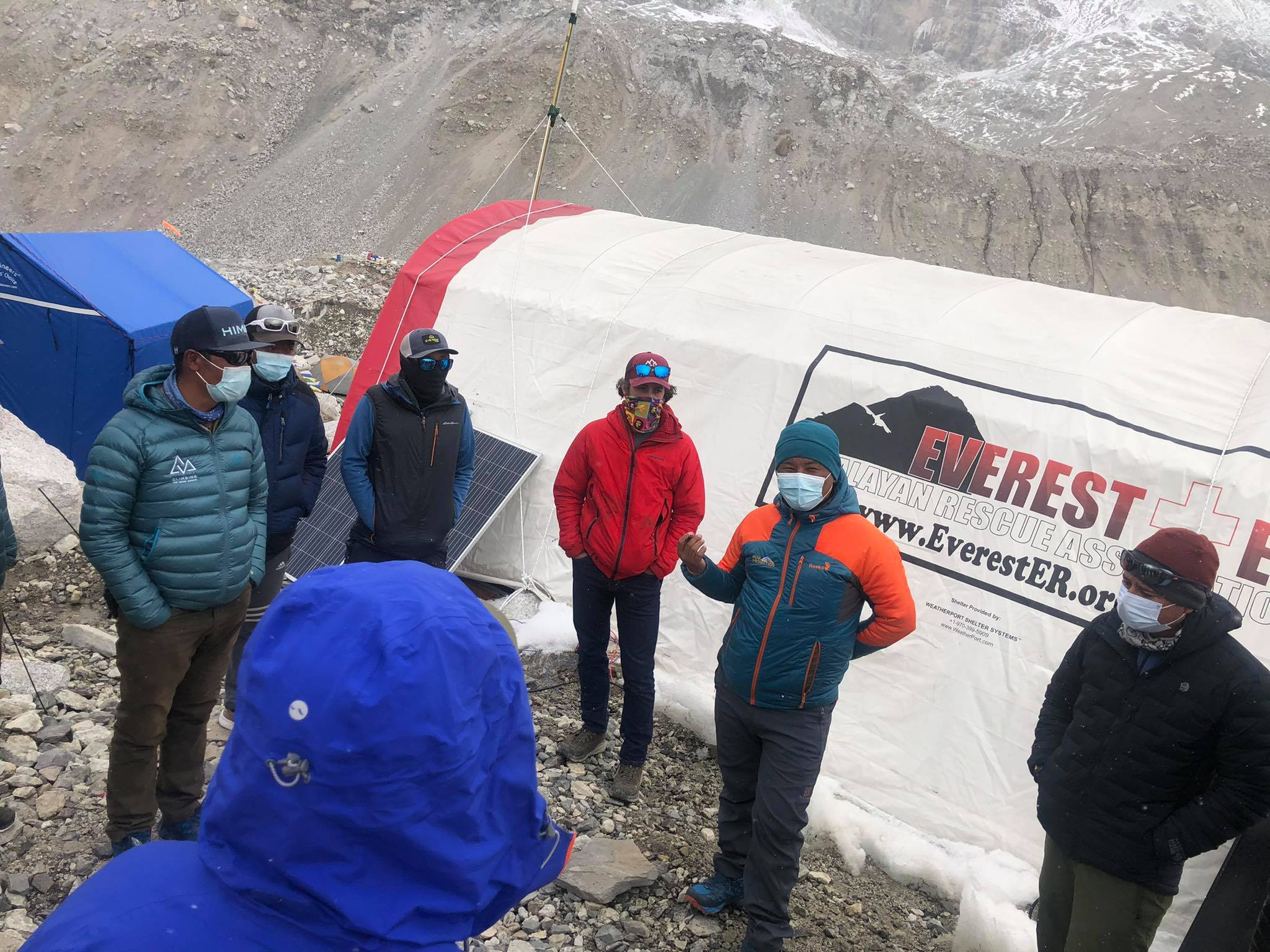Standing people outside the medical tent at Everest Base Camp