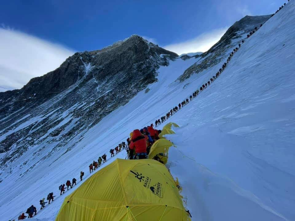 Huge line of climbers in shadow on Everest