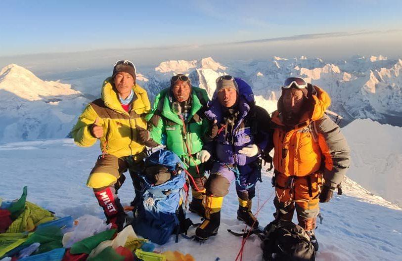4 Sherpas on the sunny summit of Everest