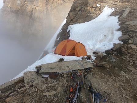 A precarious tentsite on a sharp ridge