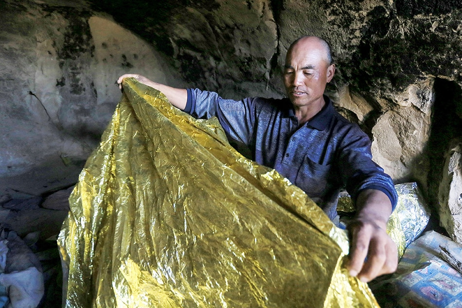 The shepherd who saved six runners in China from death by hypothermia.