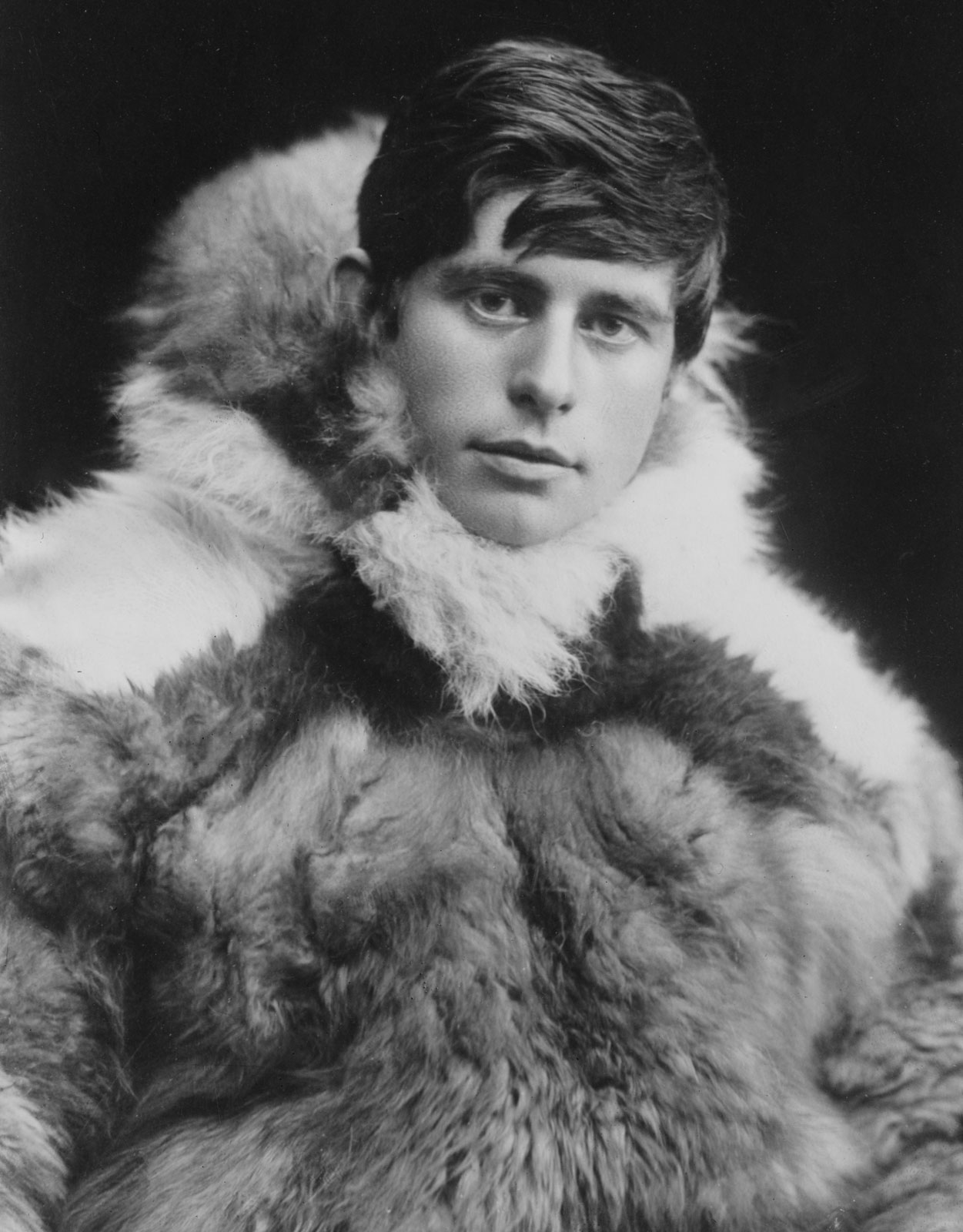 Black and white photo of a young Knud Rasmussen in furs