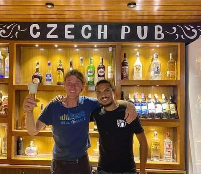 Two men in front of a Czech pub in Kathmandu
