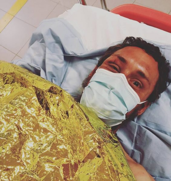 In bed in the hospital after his close call