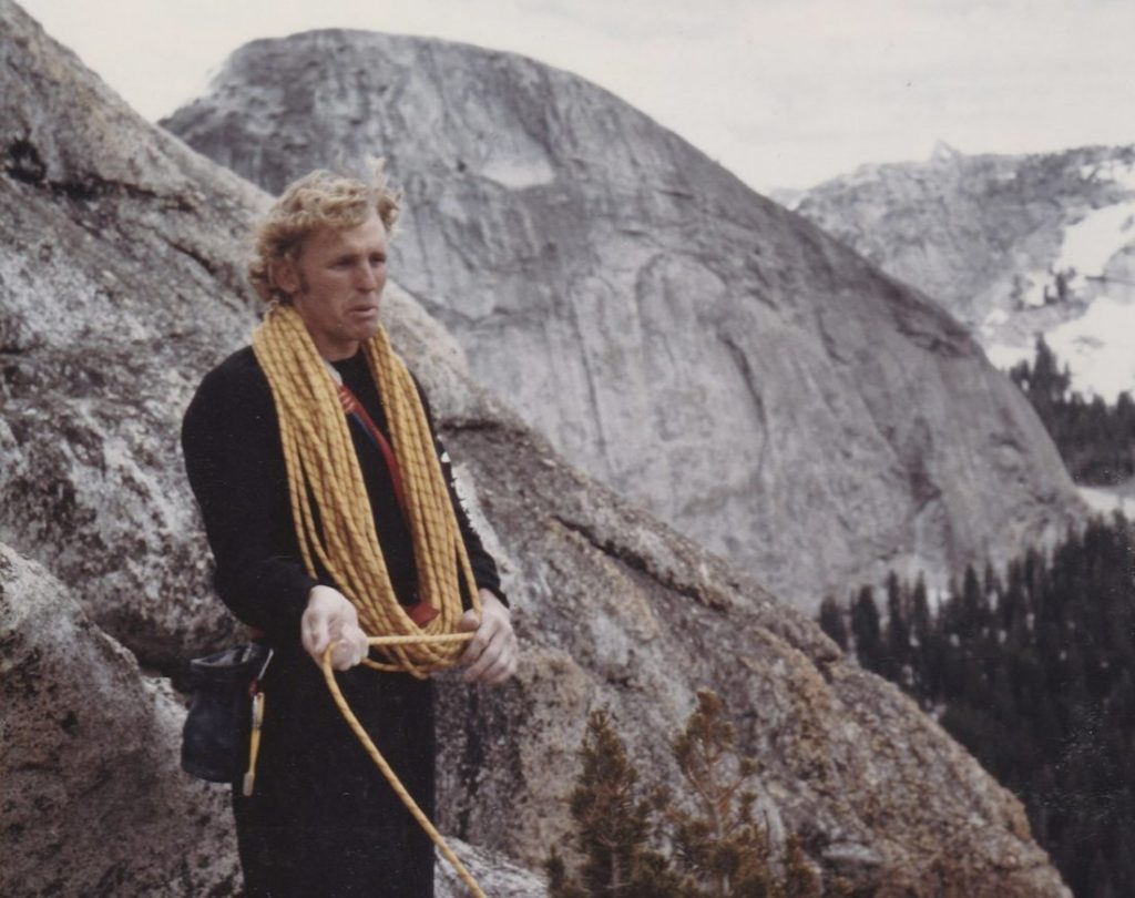 Climber with coiled rope around his neck.
